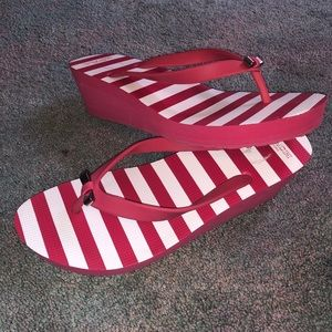 Hot pink striped COACH wedge flip flops